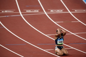 loo, jones, olympics, 100 meter hurdles,cry,, sad, horisontal, olympics, china, beijing 2008, summer olympics, run, runner, trip, hurdle, track, athletics, one person, one woman, athlete,