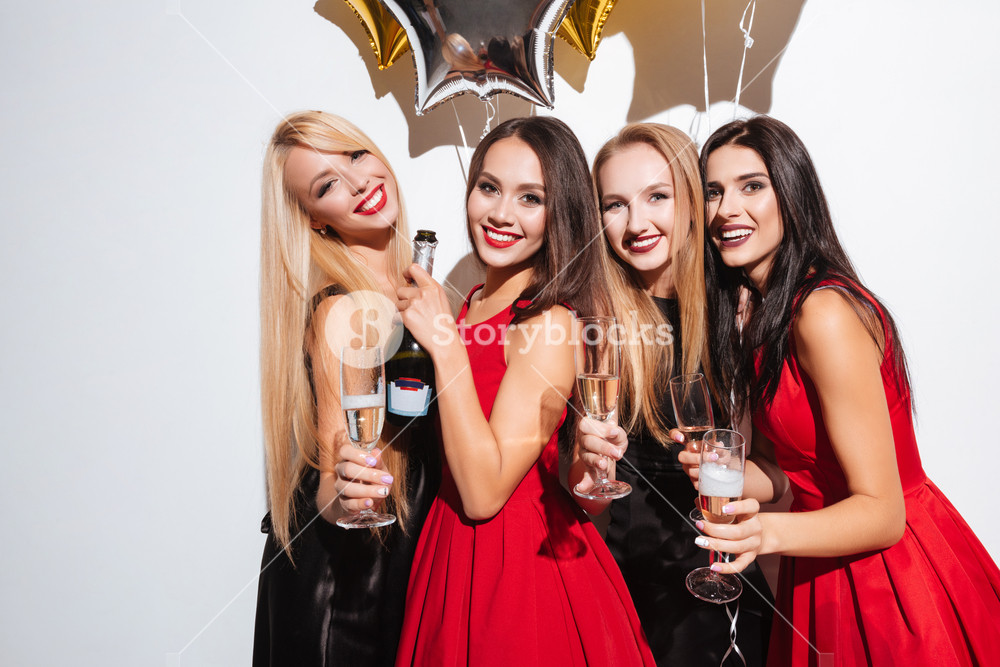 graphicstock-four-cheerful-young-women-having-party-and-drinking-champagne-over-white-background_SOZ2yVw2g_SB_PM